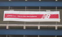 new balance parking lot with banner.jpg